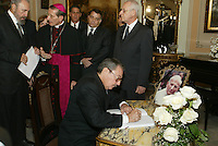"HAVANA, CUBA: April 4, 2005.- Cuban President Fidel Castro signed the ""Book of Condolences"" at the headquarters of the Catholic Nunciature in Havana for the death of Pope John Paul II. The Cuban Cardinal Jaime Ortega, who with Pope Francisco helped the restoration of relations between Cuba and the United States. Ortega will leave the leadership of the Catholic Church on the island, said Vatican. . Credit: Jorge Rey/MediaPunch"