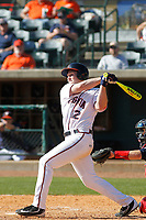 University of Virginia Cavaliers outfielder Charlie Cody (12) at bat during a game against the Liberty University Flames at Joseph P. Riley Ballpark on February 17, 2017 in Charleston, South Carolina. Virginia defeated Liberty 10-2. (Robert Gurganus/Four Seam Images)