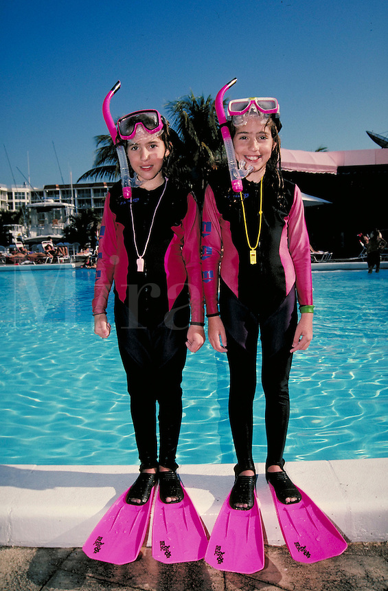 Portrait of two girls in full snorkel gear. Children. Douglaston NY.