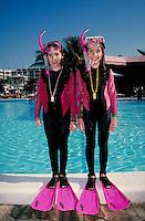 Portrait of two girls in full snorkel gear. Children. Douglaston NY.