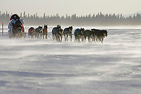 Lance Mackey sits behind his sled as he runs on the Yukon river between Eagle Island & Kaltag in 35-40 mph wind