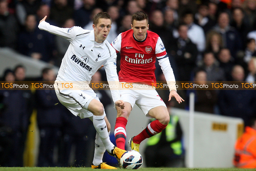 Gylfi Sigurosson of Tottenham Hotspur and Carl Jenkinson of Arsenal - Tottenham Hotspur vs Arsenal at the White Hart Lane Stadium - 03/03/13 - MANDATORY CREDIT: Dave Simpson/TGSPHOTO - Self billing applies where appropriate - 0845 094 6026 - contact@tgsphoto.co.uk - NO UNPAID USE.