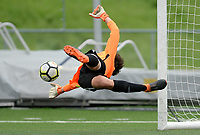 Osbourn goalie dives to make a save during Battlefield's 2-0 over Osbourn in the Cedar Run District Championship game 5-17-18 at Patriot H.S..