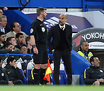 Manchester City's Pep Guardiola argues with the linesman during the Premier League match at the Stamford Bridge Stadium, London. Picture date: April 5th, 2017. Pic credit should read: David Klein/Sportimage