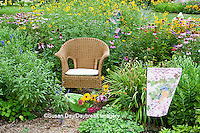 63821-206.07  Wicker chair with basket, garden flag and birdhouse in flower garden with Black-eyed Susans (Rudbeckia hirta), Purple Coneflowers (Echinacea purpurea), Gray-headed Coneflowers (Ratibida pinnata) and Pink Bee balm (Monarda fistulosa) Marion Co. IL