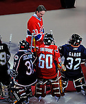 22 November 2008: The Montreal Canadiens, celebrating their 100th season, honor goaltender Patrick Roy seen here greeting young goaltenders. The Canadiens retired his jersey (Number 33) during pre-game ceremonies prior to a game against the Boston Bruins at the Bell Centre in Montreal, Quebec, Canada. Roy, played on two Stanley Cup teams with Montreal (1986 and 1993), and appeared in 114 playoff games for the Habs, the most of any goalie in Canadiens history. ***** Editorial Use Only *****..Mandatory Photo Credit: Ed Wolfstein Photo *** Editorial Sales through Icon Sports Media *** www.iconsportsmedia.com