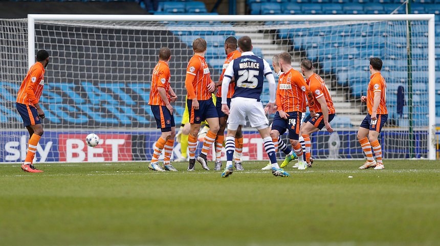 GOAL - Millwall's Jed Wallace scores his sides second goal from a free kick<br /> <br /> Photographer Craig Mercer/CameraSport<br /> <br /> Football - The Football League Sky Bet League One - Millwall v Blackpool - Saturday 5th March 2016 - The Den - Millwall<br /> <br /> &copy; CameraSport - 43 Linden Ave. Countesthorpe. Leicester. England. LE8 5PG - Tel: +44 (0) 116 277 4147 - admin@camerasport.com - www.camerasport.com
