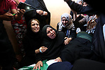 Relatives of 24-year-old Palestinian Mohammed al-Hamayda, who was killed by Israeli troops during clashes in tents protest where Palestinian demand the right to return to their homeland at the Israel-Gaza border, mourn over his body during his funeral in Rafah in the Southern Gaza Strip on June 30, 2018. Photo by Ashraf Amra