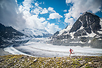 Trail running a loop from Fionnay, to Col des Ottans, to Cabane de Pannosiere and back to Fionnay, Val de Bagnes, Switzerland. Running along the Glacier de Corbassière with Grand Combin the distance.