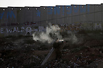 Israeli border policeman fires a tear gas canister at Palestinian stone-throwers during clashes with Palestinian stone-throwers at the Kalandia checkpoint between the West Bank city of Ramallah and Jerusalem, Thursday, Oct. 8, 2009. President Barack Obama's Mideast envoy finds himself increasingly hamstrung, with Israel's foreign minister on Thursday all but ruling out a peace deal for years to come and the Palestinian leader weakened by his decision not to push for a Gaza war crimes tribunal against Israel.. Photo by Mohamar Awad
