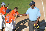 Jersey GSV players give the home plate umpire a fist bump during their introduction before a game.