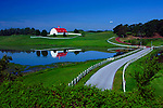 Picturesque farm scene with a red roofed barn sitting on the rolling hills of central Alabama.
