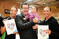 Minister of Sport Grant Robertson (centre) with P.I.C netballers Mila Reuelu-Buchanan (left) and Ngarama Milner-Olsen, and baby Indie-Blu Craig. Value Of Sport Launch at ASB Sports Centre in Wellington, New Zealand on Saturday, 17 March 2018. Photo: Dave Lintott / lintottphoto.co.nz