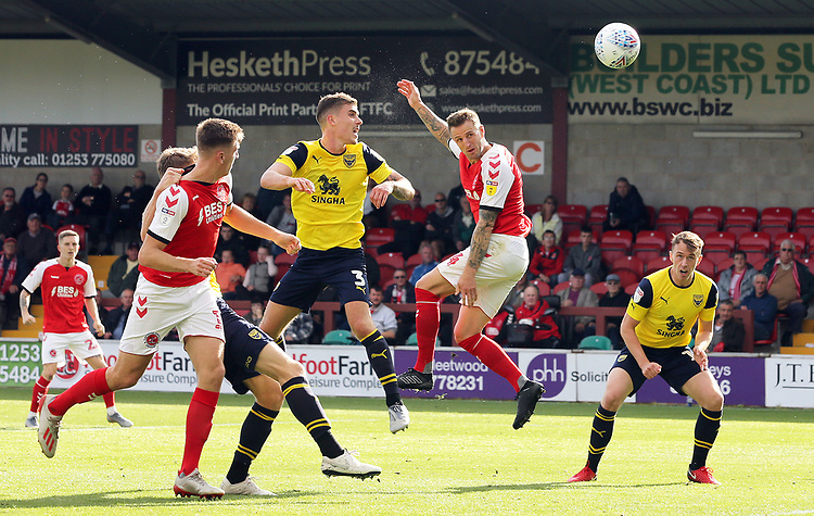Fleetwood Town's Peter Clarke scores his side's second goal despite the attentions of Oxford United's Josh Ruffels<br /> <br /> Photographer Rich Linley/CameraSport<br /> <br /> The EFL Sky Bet League One - Fleetwood Town v Oxford United - Saturday 7th September 2019 - Highbury Stadium - Fleetwood<br /> <br /> World Copyright © 2019 CameraSport. All rights reserved. 43 Linden Ave. Countesthorpe. Leicester. England. LE8 5PG - Tel: +44 (0) 116 277 4147 - admin@camerasport.com - www.camerasport.com