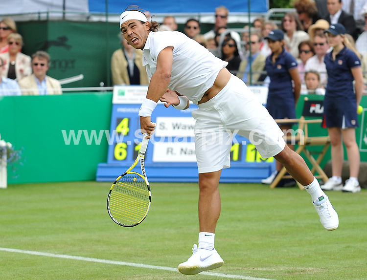 **ALL ROUND PICTURES FROM SOLARPIX.COM**.**WORLDWIDE SYNDICATION RIGHTS**.Spanish tennis star Rafael Nadal lost a pre-Wimbledon exhibition match at The Hurlingham Club in West London yesterday to Australia's Lleyton Hewitt and showed signs that he has not fully recovered from lingering knee problems. He also looks to be out of this years Wimbledon Tennis Tournament due to the injury..JOB REF:    9294   SSD     DATE:  20.06.09.**MUST CREDIT SOLARPIX.COM OR DOUBLE FEE WILL BE CHARGED**.**ONLINE USAGE FEE GBP 50.00 PER PICTURE - NOTIFICATION OF USAGE TO PHOTO @ SOLARPIX.COM**.**CALL SOLARPIX : +34 952 811 768 or LOW RATE FROM UK 0844 617 7637**