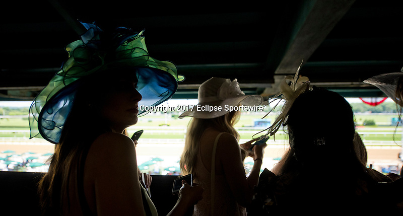 ELMONT, NY - JUNE 10: Three women watch the races on Belmont Stakes Day at Belmont Park on June 10, 2017 in Elmont, New York (Photo by Scott Serio/Eclipse Sportswire/Getty Images)