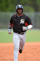 Miami Marlins outfielder Miles Williams (22) runs the bases after hitting a home run during a minor league spring training game against the New York Mets on March 28, 2014 at the Roger Dean Stadium Complex in Jupiter, Florida.  (Mike Janes/Four Seam Images)