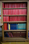 Bookcase of hymn song books and bibles inside a christian church