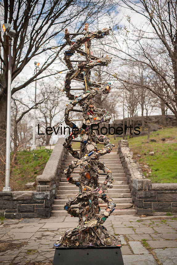 """""""DNA Totem"""" by the artist Suprina Kenney is seen in Marcus Garvey (Mount Morris) Park in Harlem in New York on Saturday, April 2, 2016. The 9-foot tall public sculpture represents a strand of DNA and is made of steel in which the artist has embedded discarded objects that she has found on the streets. The sculpture will be on view until September 30, 2016.  (© Richard B. Levine)"""