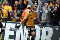 Newports Christian Jolley celebrates in front of the Newport supporters after scoring his sides first goal during the Newport County v Wrexham Blue Sq. Bet Premier league playoff final at Wembley Stadium, London, England Sunday 5th May 2013. Credit for pictures to Jeff Thomas Photography - www.jaypics.photoshelter.com - 07837 386244 - Use of images are restricted without prior permission of the copyright owner Jeff Thomas Photography.