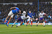 Ellis Harrison of Portsmouth hets to a header ahead of Ro-Shaun Williams of Shrewsbury Town during Portsmouth vs Shrewsbury Town, Sky Bet EFL League 1 Football at Fratton Park on 15th February 2020