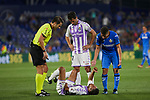Getafe CF's Francisco Portillo and Real Valladolid's Ivan Lopez 'Ivi' and Borja Fernandez (down) have words with referee Cordero Vega during La Liga match. August 31, 2018. (ALTERPHOTOS/A. Perez Meca)