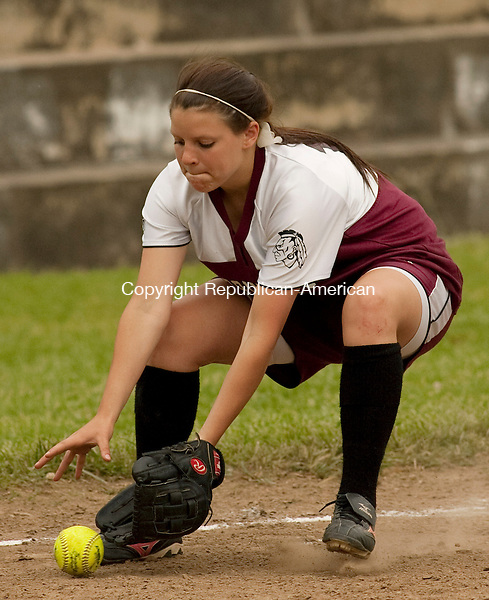 WATERBURY CT- MAY 17 2010-051710JS07-Torrington's Baylee Vinisko (10) scoops up a ground ball during their game against Kennedy Monday at Kennedy High School in Waterbury.<br /> Jim Shannon Republican-American
