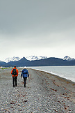 USA, Alaska, Homer, a couple hikes down the beach at Land's End, the Homer Spit, Kenai mountains in the distance