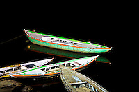 Ferry boats and their reflection in the dark waters of a quiet Ganges. (Photo by Matt Considine - Images of Asia Collection)
