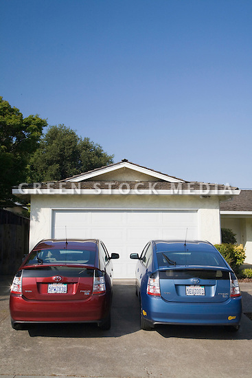 Two Toyota Prius hybrid cars parked on a driveway of home. Cupertino, California, USA