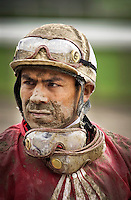 Saratoga Springs, NY  Jockey covered in dirt after a r thoroughbred horse race at the New York Racing Association horse track here..©Mitch Wojnarowicz