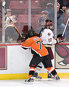 James Perkin 7 of Bowling Green pins Joe Rooney 17 of Boston College to the boards. The Eagles of Boston College defeated the Falcons of Bowling Green State University 5-1 on Saturday, October 21, 2006, at Kelley Rink of Conte Forum in Chestnut Hill, Massachusetts.<br />