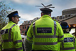 © Joel Goodman - 07973 332324 . 21 November 2013 . Manchester , UK . Police Community Support Officers in Albert Square in front of the Windmill pub . Candid photos of the Christmas Markets in Manchester City Centre . Photo credit : Joel Goodman