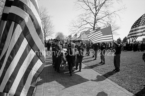 Mardela Springs, Maryland.USA.March 20, 2007..The coffin of Sgt. Thomas Lee Latham arrives as honor guards bear flags along the entrance to Maryland Veterans Cemetery in Hurlock. ..Sgt. Thomas Lee Latham died March 11 in Baghdad, Iraq, of wounds sustained when an improvised explosive device detonated near his Humvee. He was assigned to the 2nd Battalion, 14th Infantry Regiment, 2nd Brigade Combat Team, 10th Mountain Division, Fort Drum, N.Y.
