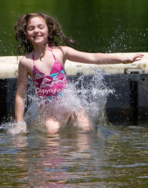 WATERTOWN CT. 10 July 2015-071015SV05-Ella Wesson, 7, of Watertown jumps off the dock at Sylvan Lake Park in Watertown Friday. She was there with her sister and grandmother enjoy in the warm summer day.  <br /> Steven Valenti Republican-American