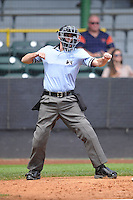 Home plate umpire Brandin Sheeler calls strike three during the Midwest League game between the Clinton LumberKings and the Beloit Snappers at Ashford University Field on June 12, 2016 in Clinton, Iowa.  The LumberKings won 1-0.  (Dennis Hubbard/Four Seam Images)