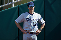 Xavier Musketeers assistant coach Nick Otte (13) stands in the bullpen prior to the game against the Penn State Nittany Lions at Coleman Field at the USA Baseball National Training Center on February 25, 2017 in Cary, North Carolina. The Musketeers defeated the Nittany Lions 10-4 in game one of a double header. (Brian Westerholt/Four Seam Images)