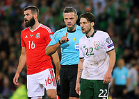 Referee Damin Skomina (C) speaks to Harry Arter of Ireland (R) during the FIFA World Cup Qualifier Group D match between Wales and Republic of Ireland at The Cardiff City Stadium, Wales, UK. Monday 09 October 2017