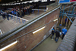 Peterborough United 1 Chesterfield 0, 21/03/2015. Abax Stadium, League One. Home supporters in the London Road stand covered terrace making their way from the ground at the final whistle at the Abax Stadium, as Peterborough United play Chesterfield in a SkyBet League One fixture. The home team won the match by one goal to nil, watched by a crowd of 6,612. The result allowed Peterborough to leapfrog their opponents into the League One play-off positions with eight games remaining of the season. Photo by Colin McPherson.