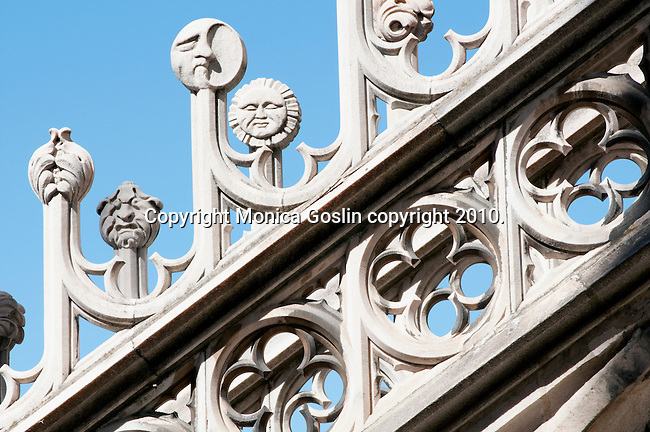 Detail of the carved marble, in the shape of a moon and sun, on the roof of the Duomo (Cathedral) in Milan, Italy.