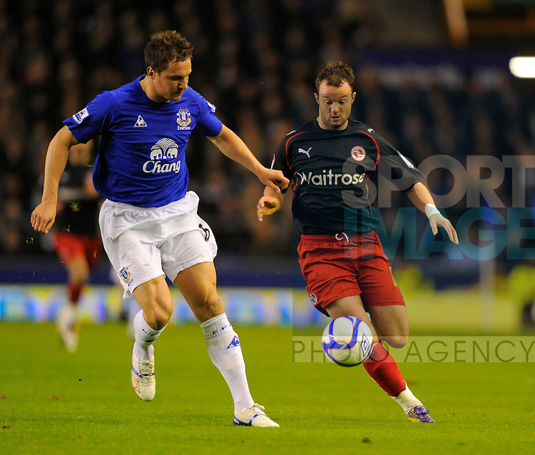 Phil Jagielka of Everton and Noel Hunt of Reading