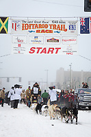 Gerry Willomitzer and team leave the ceremonial start line at 4th Avenue and D street in downtown Anchorage during the 2013 Iditarod race. Photo by Jim R. Kohl/IditarodPhotos.com