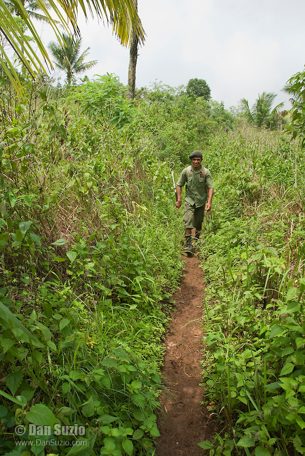 Timorese student Laca Ribeiro walks a trail on Atauro Island, Timor-Leste (East Timor)