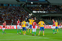 Hungary's goalkeeper Gabor Kiraly (C) jumps for the ball during the UEFA EURO 2012 Group E qualifier Hungary playing against Sweden in Budapest, Hungary on September 02, 2011. ATTILA VOLGYI