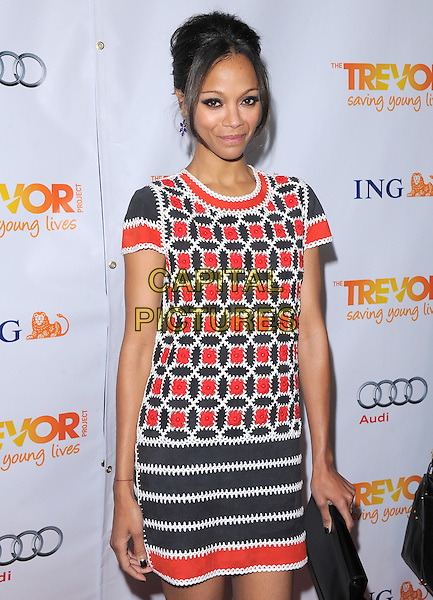Zoe Saldana.Trevor Live at The Hollywood Palladium in Hollywood, California, USA..December 4th, 2011  .half length dress clutch bag white black red print .CAP/RKE/DVS.©DVS/RockinExposures/Capital Pictures.