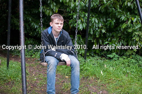 On the swings, Summerhill School, Leiston, Suffolk. The school was founded by A.S.Neill in 1921 and is run on democratic lines with each person, adult or child, having an equal say.  You don't have to go to lessons if you don't want to but could play all day.  It gets above average GCSE exam results.