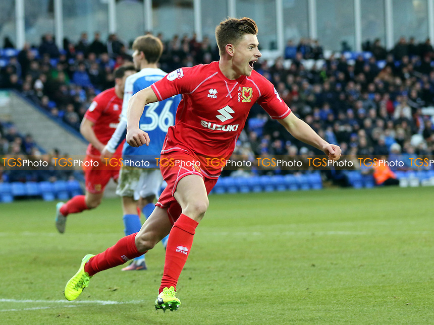 Harvey Barnes scores and turns away to celebrate MK Dons opening goal during Peterborough United vs MK Dons, Sky Bet EFL League 1 Football at London Road on 28th January 2017