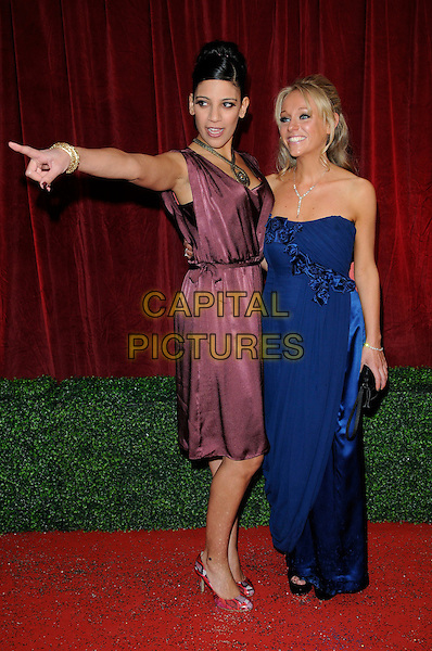 Vineeta Rishi & Sophie Abelson.Doctors.Attending the British Soap Awards 2012.at the London Television Centre, London, England, UK, 28th April 2012..arrivals full length strapless blue dress long maxi black platform shoes clutch bag open toe purple pink finger hand arm pointing gesture .CAP/CAN.©Can Nguyen/Capital Pictures.