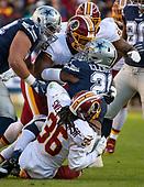 Dallas Cowboys running back Ezekiel Elliott (21) is gang-tackled by Washington Redskins free safety D.J. Swearinger (36), defensive end Jonathan Allen (93) and linebacker Preston Smith (94) in first quarter action at FedEx Field in Landover, Maryland on Sunday, October 21, 2018.<br /> Credit: Ron Sachs / CNP
