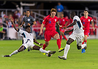 WASHINGTON, DC - OCTOBER 11: Erick Rizo #3 of Cuba tries to tackle Josh Sargent #19 of the United States during a game between Cuba and USMNT at Audi Field on October 11, 2019 in Washington, DC.